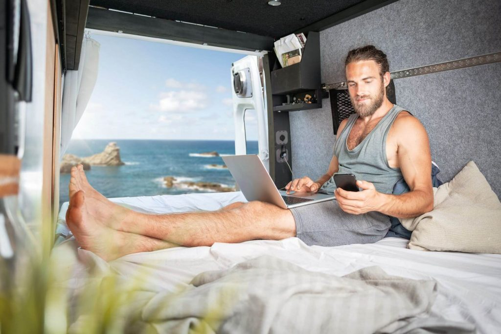 a digital nomad working out of a van