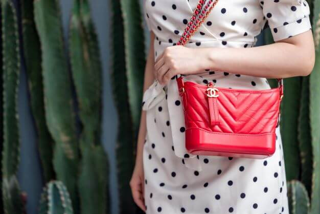 women with red chanel bag